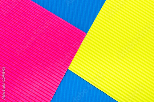 Fotografía  Pink blue and yellow color corrugated cardboard texture background