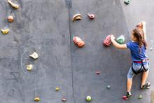 Beautiful Young Girl Climbing ...