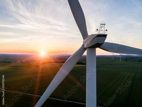 Fototapeta  Sunset above the windmill on the field