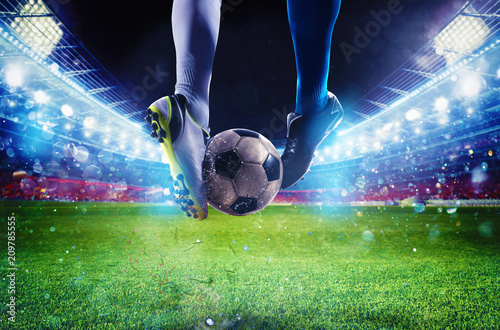 Canvas Print Soccer players with soccerball at the stadium during the match