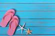 Flipflops starfish summer beach blue wood background border