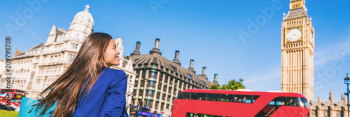 Happy tourist woman relaxing in London city at Westminster Big ben and red bus. Europe destination travel lifestyle.