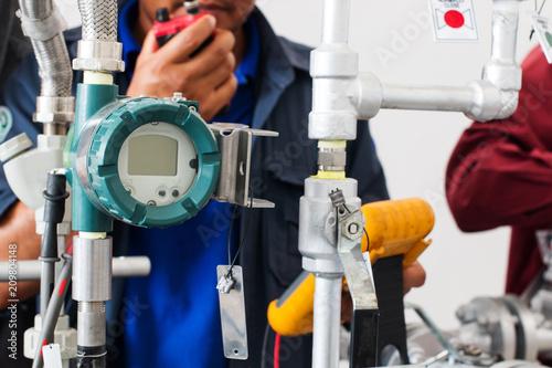 Billede på lærred Engineer testing process, Industrial measurement sensor, Temperature transmitter
