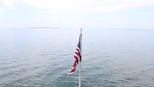 USA Flag Over Water