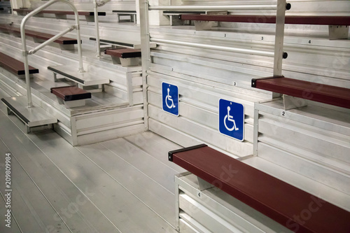 Handicapped seating among metal bleachers at an  arena Fototapet