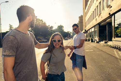 Fotografia, Obraz  A picture of a group of friends having fun in the city