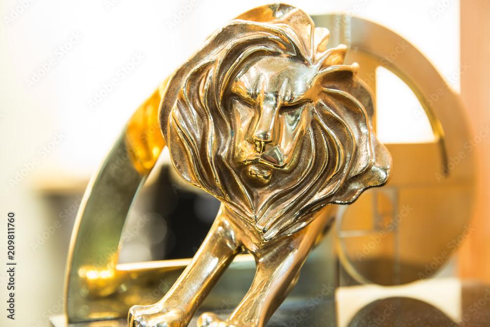 Fototapeta Closeup of gold cannes lion trophy, Shoot at Cannes lions festival 2017, France