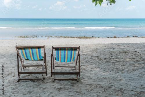 Foto op Aluminium Strand Colorful wooden beach chairs