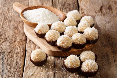 Keuken foto achterwand Snoepjes Authentic brazilian sweets beijinhos with condensed milk and coconut close-up. horizontal