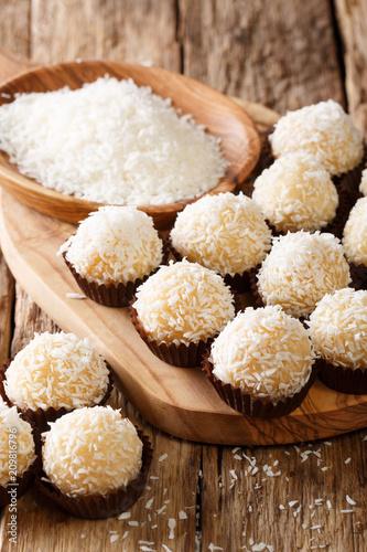 Foto op Aluminium Snoepjes Delicious coconut kisses( beijinhos de coco or branquinhos) - festive Brazilian sweets close-up. vertical