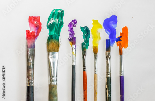 DIFFERENT ARTISTIC BRUSHES ON THE WHITE BACKGROUND,