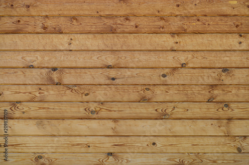 Papiers peints Bois wall of wooden planed logs square section