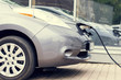 .The electric car is on a charge..Close-up.Toned