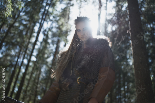 Viking woman wearing traditional warrior clothes in a deep mysterious forest Canvas Print