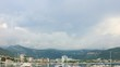 Time lapse, clouds moving over the Budva city and mountains, Adriatic sea coastline in Montenegro