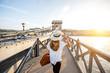 Leinwandbild Motiv Young woman traveler walking on the famous Chain bridge during the sunset in budapest, Hungary