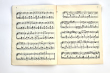 Book With Musical Notes. A Musical Book With Musical Notes On Light Background, Top View.