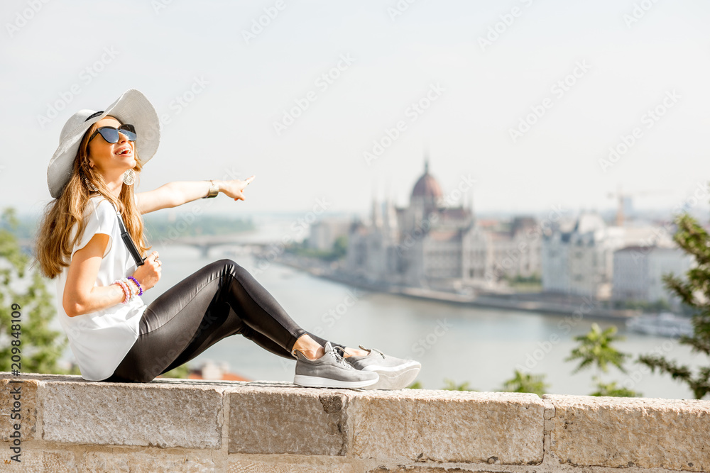 Fototapety, obrazy: Young woman tourist enjoying great citysacape view traveling in Budapest city, Hungary