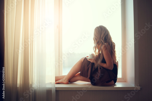 Young Beautiful Girl Drinking Coffee Sitting Near The Window In Morning Blond Sexy -2961