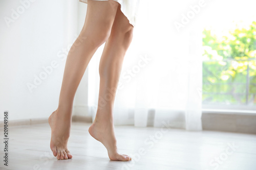 Young Woman With Sexy Legs Walking Barefoot At Home