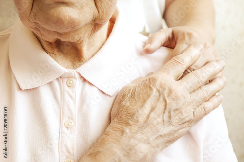 Fotografía Mature female in elderly care facility gets help from hospital personnel nurse