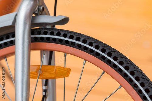 details of bicycle wheel in park, close up of flat-free or airless bike tire © happycreator