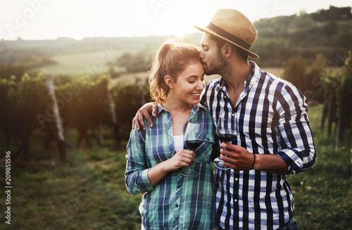 Fotografie, Obraz  Couple in love working at winemaker vineyard