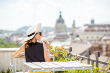 Woman Enjoying Great Cityscape View From The Terrace On The Old Town With Saint Stephen Cathedral In Budapest City, Hungary