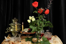 Still Life With Bouquet Of Roses, Wine, Candles, Skull And Samovar