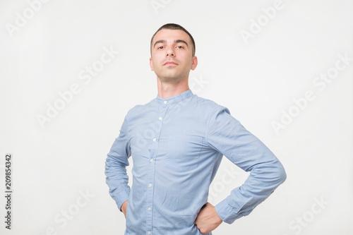 Handsome young man standing like a super hero Slika na platnu