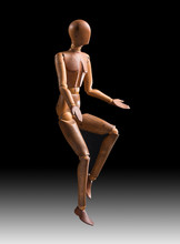 Wooden Mannequin Jumping On A Black And White Gradient Background, Vertical