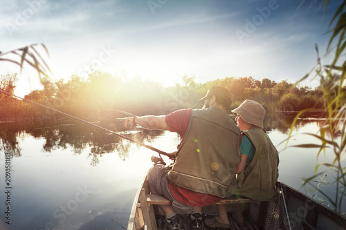 Foto op Plexiglas Vissen Fishing by the lake is our common passion