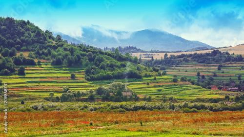 Spoed Foto op Canvas Turkoois Mountain landscape in summer with cumulus clouds.