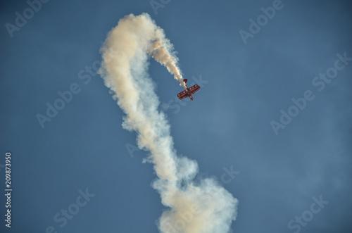 A stunt plane performance at an air show. Canvas Print