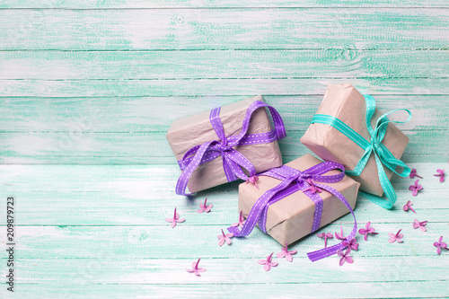 Wrapped gift boxes and lilac flowers