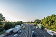 canvas print picture - Sunset view heavy traffic moving at speed on UK motorway in England