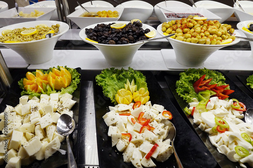 Foto op Canvas Buffet, Bar Mixed cheeses in the cupboard .Cheese platter with vegetables .