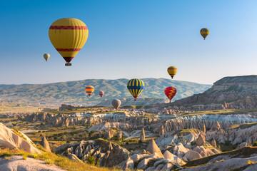 Obraz na SzkleHot air balloons flying over Cappadocia, Turkey