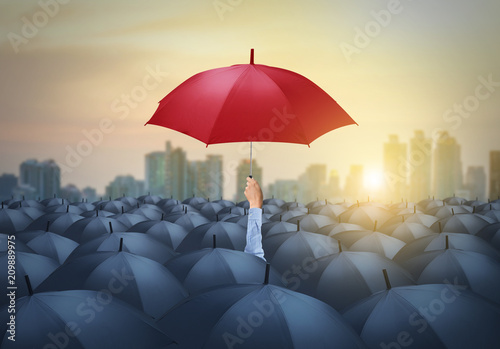 businessman with red umbrella among others, unique different concept Canvas Print