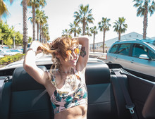Young Woman Riding Cabriolet