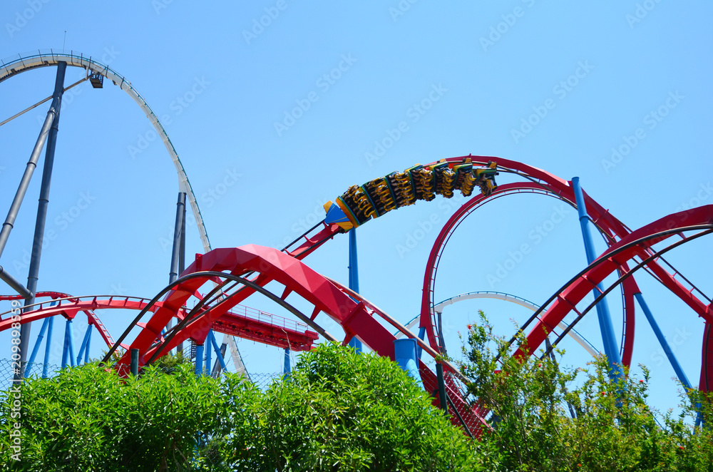 Fototapety, obrazy: Big Roller Coaster in Amusement Park in a Sunny Day
