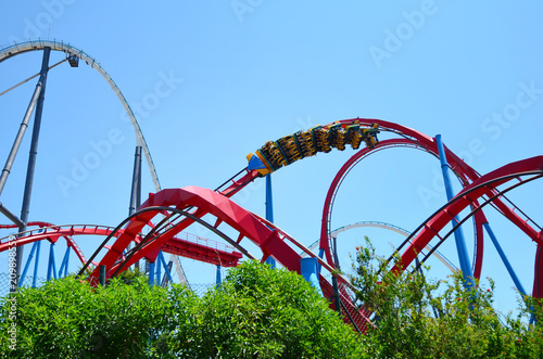 Fotografia  Big Roller Coaster in Amusement Park in a Sunny Day