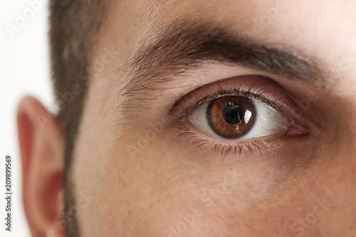 Obraz Close up view of a brown man eye looking at camera - fototapety do salonu
