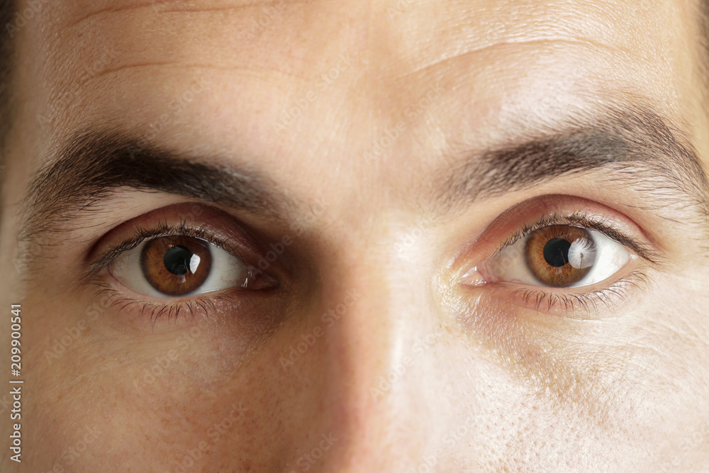 Fototapety, obrazy: Close up view of a brown man eyes looking at camera