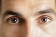 Close up view of a brown man eyes looking at camera