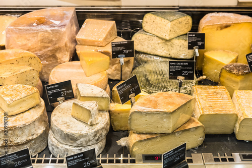 Different cheeses on display in a French supermarket. Paris, France