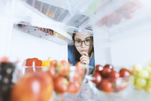 Woman Taking Healthy Food From...