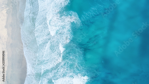 Waves on the beach as a background. Beautiful natural background at the summer time - 209904146