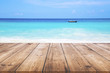 Wood table with blue sea and sand beach background