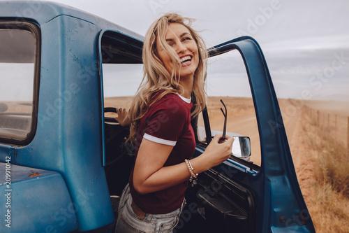 Fotografie, Obraz  Woman taking break from the road trip